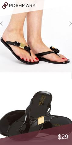 Ted Baker Hatha Jelly Bow Flip Flop black PVC jelly toe post flip flop featuring a decorative bow trim on the strap, branded with Ted Baker metal hardware. UK3/US5 - Very good preloved condition. Note small mark on the back of one shoe. Ted Baker Shoes Sandals