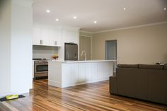 A recently completed renovation by the M.J.Harris Group in Diamond Creek. Select Grade Spotted Gum Flooring, timber bifolds and a beautiful kitchen in Diamond Creek. Photography by J.Harri