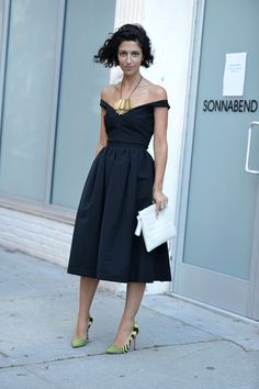 Fashion consultant Yasmin Sewell stays chic in the heat in an off-the-shoulder look.