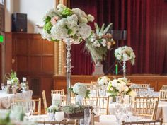Wisteria Flowers and Gifts | Rustic chic wedding, tall centerpieces