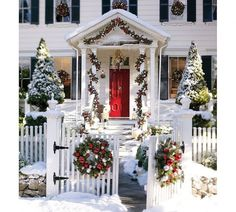 White Christmas House With Decorations Outdoor Christmas Decoration Ideas. Beautiful, traditional Colonial chrismas decor from picket fence gate to column portico and wreaths in every shuttered window. Christmas Porch, Noel Christmas, Merry Little Christmas, Outdoor Christmas Decorations, Christmas Lights, Christmas Wreaths, White Christmas, Christmas Entryway, House Decorations