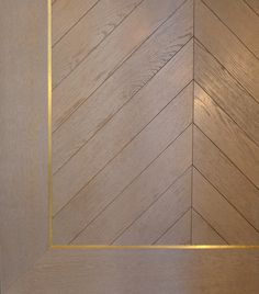 Oak Chevron with brass inlay border