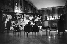 """WOW... Picasso's Guernica in such a setting.  Rene Burri ITALY. Lombardia region. Town of Milan. 1953. Palazzo Reale. PICASSO exhibition showing """"Guernica"""". This monumental canvas which became an international symbol of the Spanish Republican cause. The city was completely destroyed by an air raid on the 29th April 1937, it was claimed that the bombing had not been done by the Nationalist forces, but by the Condor Legion of the German air force under the direction of Franco's government."""