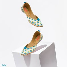 Stand out in every occasion with our Blue Flower Print on White Pintuck Mojari.