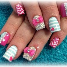 Creative nail designs with 3D bows by Ashley Binnie | Yelp