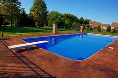 Google Image Result for http://www.kleinslandscaping.com/Hardscapes/Photos/Concrete_Concepts/2011/Stained%2520Concrete%2520around%2520Pool%2520Massillon%2520Ohio.JPG