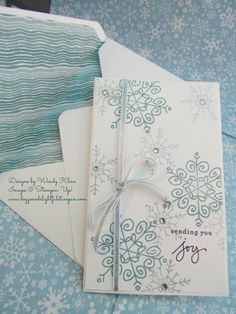 See more on my design at : http://www.doggonedelightfulstampin.com/busy_stampin/2014/08/an-endless-flurry-of-snowflakes.html.