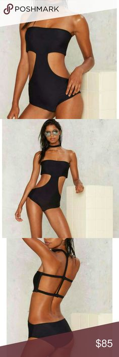 Aila Blue Cutout Swimsuit The Reef Swimsuit is black and features an attached choker, partial bandeau design with snap closure at back, cutaway at sides, and medium coverage bottom. By Aila Blue.    *Body 80% Nylon 20% Spandex *Lining   90% Polyester  10% Spandex Nasty Gal Swim