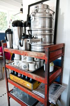 @ The Fremont Diner, an old parts rack is repurposed into a serve yourself coffee cart and recycling center.