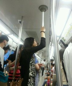 This woman will never again worry about not having a space on the subway. My question, though, is how does she manage to get it off the ceiling in time to get off the train?