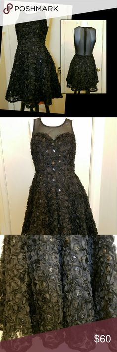 Black Prom/Cocktail Dress Floral appliqued and sequined short dress. Lined puff skirt. Sheer top front and shoulder to waist back. Unworn. Above knee length. Perfect for any occasions. A great formal holiday party dress.  Make an offer. bebe Dresses Mini