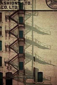 fire escape and shadow in Winnipeg by Ryan McBride Urban Photography, Color Photography, Street Photography, White Photography, Landscape Photography, Portrait Photography, Nature Photography, Fashion Photography, Wedding Photography