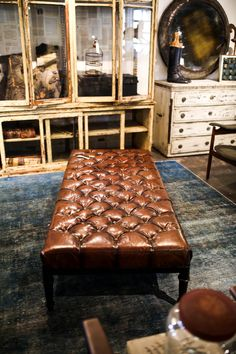Tufted leather, reclaimed materials and classic style.   BD Custom home furnishings at Georgia Brown Home.