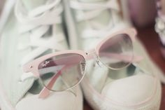 Pink Ray Ban sunglasses. Cute!
