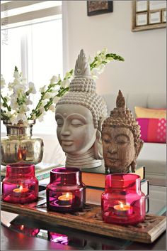 Create a Zen space in your living room with Buddha figurines and candles placed on the coffee table.