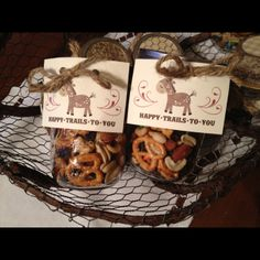 """Mason jars woth trail mix used for a cowboy themed baby shower """"Happy Trails to You""""!"""