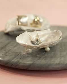 Use this charming oyster shell dish to store jewelry, keys, or any other small item.