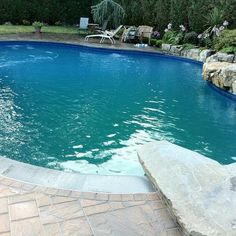 A diving rock can enhance the aesthetics around the pool