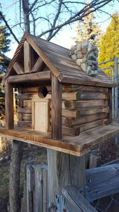 Birdhouse, Cabin Style with Stone Chimney Hand made with cedar, stone chimney,bottom door for easy access to clean 12 inch long x 12 inch wide x 10 inch tall Wooden Bird Feeders, Wooden Bird Houses, Bird Houses Diy, Fairy Houses, Bird House Plans, Bird House Kits, Squirrel Home, Homemade Bird Houses, Stone Chimney