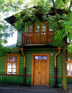 green exterior house paint | this italianate style house looks