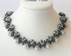 Items similar to Modern pearl loop bridal necklace on Etsy