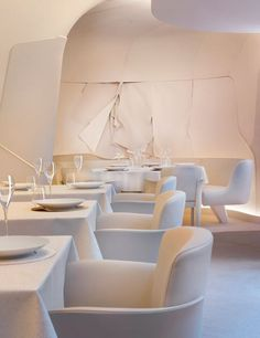 White on white interior of chef Thierry Marx's Michelin star restaurant at the #Mandarin Oriental hotel in Sur Mesure, Paris designed by partners #Patrick Jouin and #Sanjit Manku.