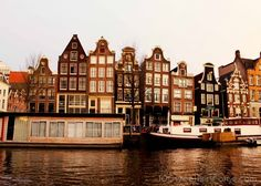 Amsterdam Canal with the 'Dancing Ladies' or severely leaning houses along the Amstel.