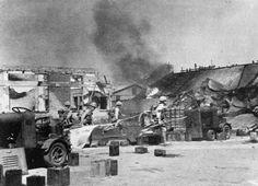 Japanese troops enter Rangoon station.
