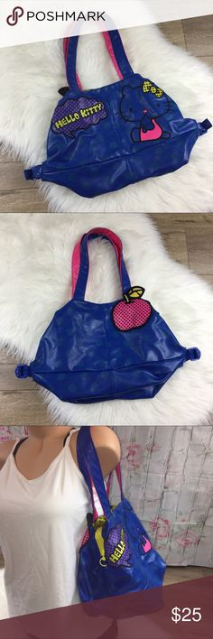 Blue polka dot patch Hello Kitty purse Unique blue polka dot hello kitty bag. Fairly large size with additional measurements available included. Zipper too as well as snaps. One inside compartment, inside yellow liner in great condition. Overall good condition one small scuff on apple and a few small scuffs in the bottom no major damage. Save 20% when bundled! Hello Kitty Bags Shoulder Bags