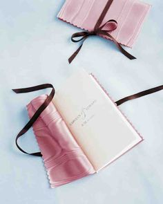 Wide moiré taffeta ribbon becomes a shimmering jacket for a wedding program. A narrow brown ribbon tied in a simple bow holds the finished booklet closed.