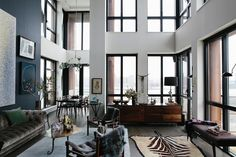 Beautiful, natural light flooding in in this gorgeous home. Home decor inspo with all white minimal and mod furniture. Pops of color through art and accent furniture.   Read the inspo post here: http://becauseimaddicted.net/2013/04/a-peek-inside-athena-calderones.html?utm_source=feedly