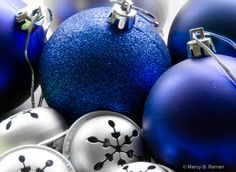 Silver bells and blue ornaments