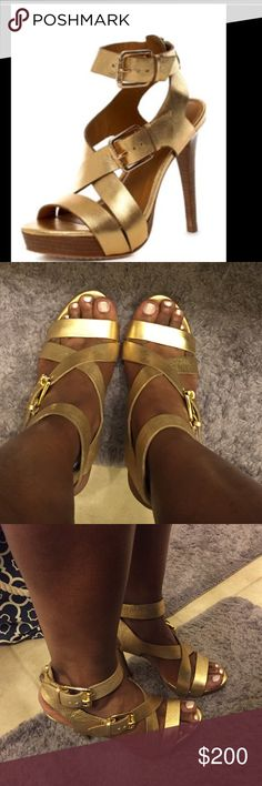 Michael Kors metallic gold sandals Michael Kors Paris metallic gold platform sandal..size 10 very comfortable sandal comes with original box and stuffing Michael Kors Shoes Sandals