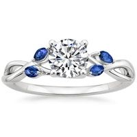 This flawless ring features delicate vines adorned with sparkling round diamonds and four marquise blue sapphire buds that reach for the center gem. The perfect combination of natural elegance and breathtaking sparkle, this engagement ring will delight nature lovers everywhere (0.15 total carat weight).
