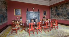 In the dining room, 20th-century lacquer-and–parcel-gilt chairs in the style of Giles Grendey surround an 18th-century mahogany table.
