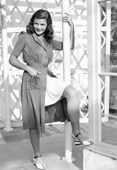 Gene Tierney movie star photo print ad model magazine vintage fashions style 40s war era button down dress over short skirt shorts casual sportswear espadrille shoes sandals