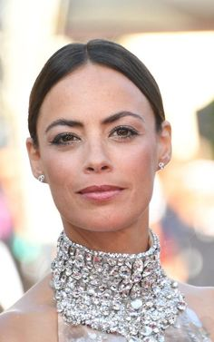 Bérénice Béjo wearingearringsin white gold and diamondsby Chaumet for the Cannes 70th Anniversary celebrations