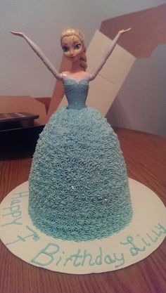 Elsa doll cake with buttercream and edible glitter. Made by Lyndsay Estep and Heather Peek