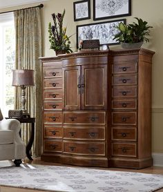 Style plus ample storage makes this grand cabinet a must in any home. Use it for a media cabinet in the living room, or let it hold linens in the bedroom.