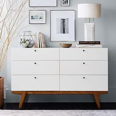 Bedroom cuboard with draw clean lines with natural woodern feet. Classic lamp shape with a accent light on the picture frames. Natural reeds nice contrast with wall. Creating a modern natural feel to the room Modern 6-Drawer Dresser #westelm