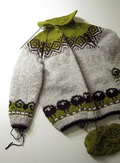 oh my god the unbearable cuteness. this is a hat by kate davies (sheep heid) converted into a cardigan. beyond awesome..