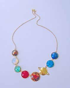 Perfect Alignment Solar System Necklace - this is a curious combination of vintage cabochons and geek chic... I kinda love its quirkiness.