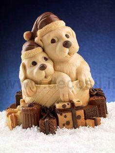Stampo in silicone alimentare per cioccolato, ideale per realizzare cagnolini immersi tra i pacchi di Natale. www.decosil.it