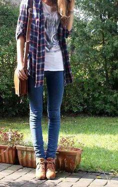 Skinny jeans + flannel shirt + graphic tee + tan purse and booties #WomenFashion