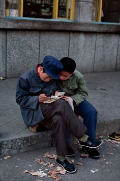Two boys looking at a Book.  Steve McCurry: gorgeous photographs of people reading around the world.