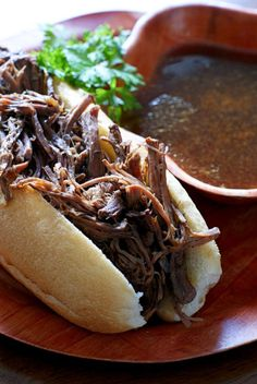 Crock Pot French Dips recipe! They are super easy to make shredded beef sandwiches served alongside a rich au jus for dipping. Perfect for a fall dinner.