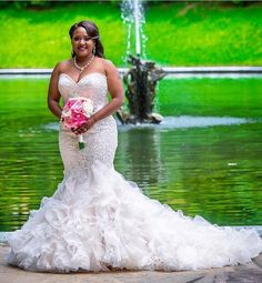 This strapless fit-and-flare wedding gown has a sweetheart but line. The beaded lace bodice adds to the flared ruffle skirt. For custom #weddingdresses like this that you can afford just contact us. We can also make #replicas of designer gowns too that will look the same in style but cost way less. See other #plussizeweddingdresses and get info on pricing when you visit us at www.dariuscordell.com/?utm_content=bufferc9b52&utm_medium=social&utm_source=pinterest.com&utm_campaign=buffer
