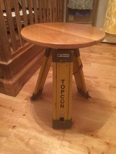Surveyors tripod used as legs for the nursery table.