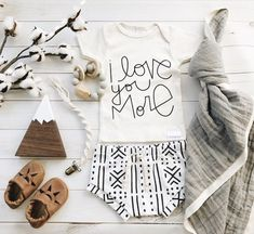 I love you More love quote   organic baby boy girl newborn clothes   figs and foxes made in USA   macrame pacifier clip   leather baby moccasins   organic cotton baby leggings harems shorts bloomers   wooden baby toys   chewable charm silicone wood teething toy   baby blanket   gender neutral nursery items   flatlay baby items shower gifts   mom to be   fall baby clothes   mudcloth