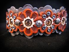 Nana Bandanas Leatherworks . Beautiful  and Local leather jewelry.